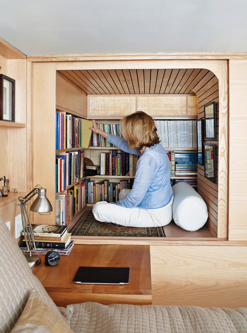 A crawl-in book cubby in an apartment designed by Tim Seggerman.