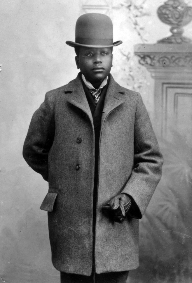 Young man in top hat and wool pant coat (1890)